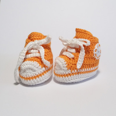 White and orange baby shoes