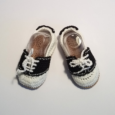 White and black baby shoes